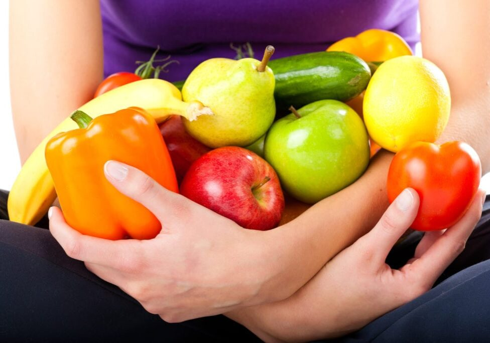 Healthy eating, happy woman with fruits and vegetables, closed-up